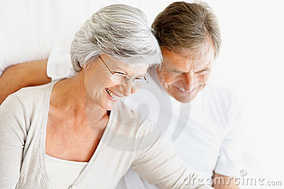 Portrait of a smiling old couple sitting together