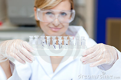 Portrait of a smiling scientist holding samples