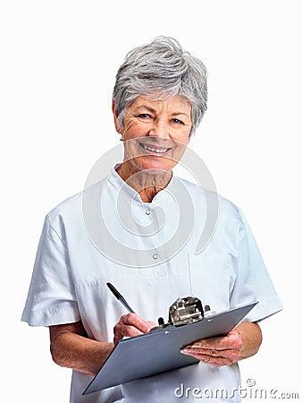 Portrait of a smiling senior nurse taking notes