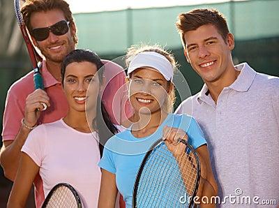 Portrait of smiling tennis team