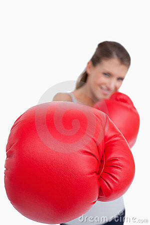 Portrait of a smiling woman boxing
