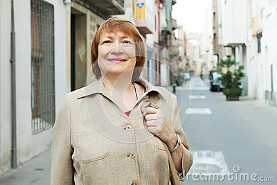 Portrait of smiling  woman at european town