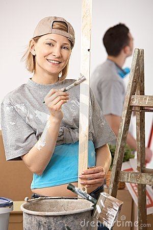 Portrait of smiling woman painting