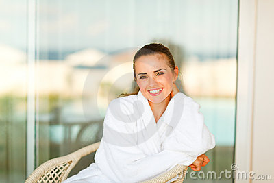 Portrait of smiling woman sitting on terrace
