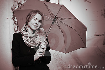 Portrait of smiling woman with umbrella