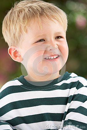 Portrait Of Smiling Young Boy Outdoors
