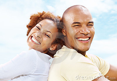 Portrait of a smiling young couple back to back