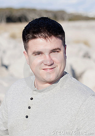 Portrait of Smiling Young Man at the Beach