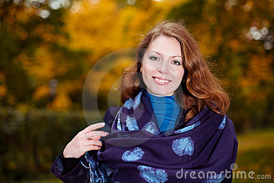 Portrait of smiling young woman with shawl