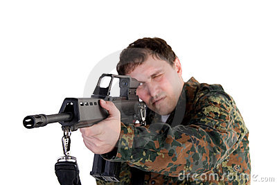 Portrait of a soldier aiming a gun