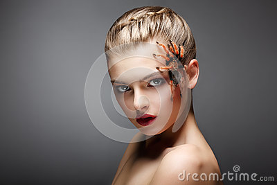 Portrait of Spider-Girl Fashion Model with Poisonous Spider on her Face