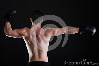 Portrait sportsman boxer in studio dark background