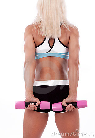 Portrait of a sportswoman lifting dumbbells