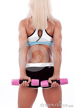 Portrait of a sportswoman lifting dumbbells