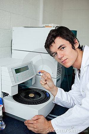 Portrait of a a student posing with a centrifuge