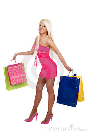 Portrait of stunning young woman carrying shopping