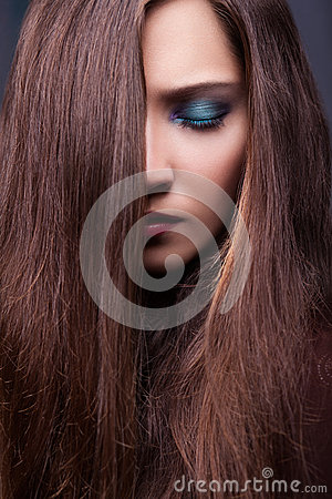 Portrait of Stylish Woman  with Long Brown Straight Hair