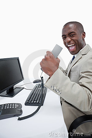 Portrait of a successful businessman using a computer