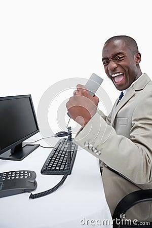 Portrait of a successful businessman using a computer