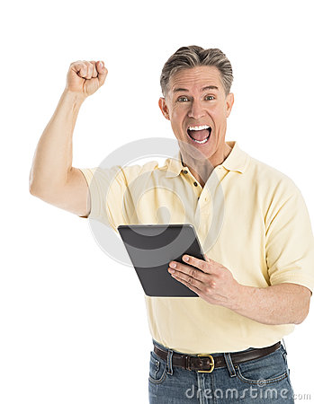Portrait Of Successful Man Shouting While Holding Digital Tablet