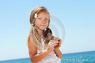 Portrait of sweet girl in white dress