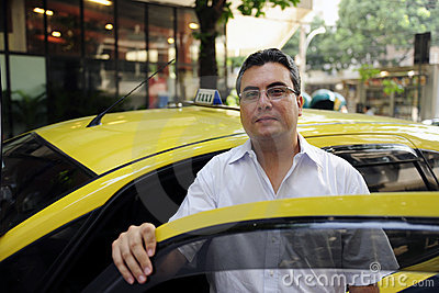 Portrait of a taxi driver with cab