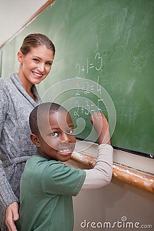 Portrait of a teacher explaining mathematics to a pupil