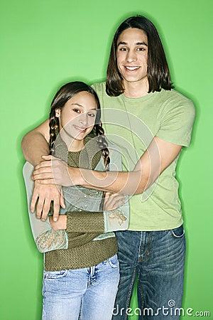 Portrait of teen boy and girl.