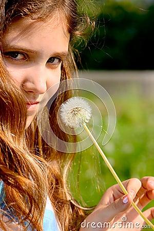 Portrait teen girl with dandelion