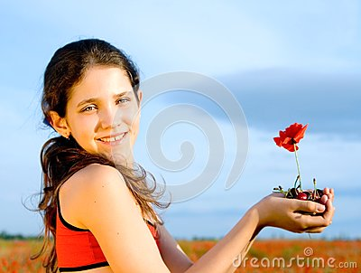 Portrait teen girl with poppy