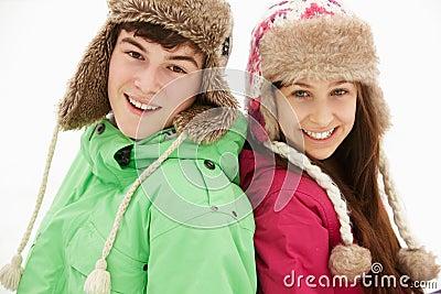 Portrait Of Teenage Couple In Snow