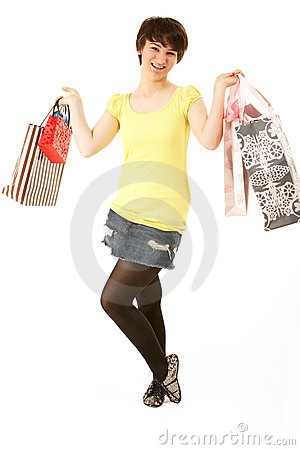 Portrait Of Teenage Girl Carrying Shopping Bags