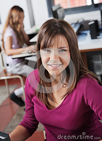 Portrait Of Teenage Girl Smiling In Computer Class