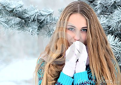 Portrait of teenage girl in winter park