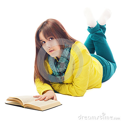 Portrait of a teenager lying on the floor reading book