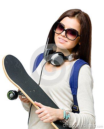 Portrait of teenager with skateboard