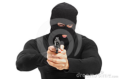 Portrait of a thief holding a gun