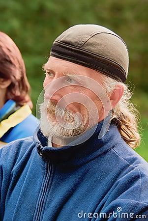 Portrait of the thoughtful elderly sportsman