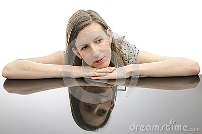 Thoughtful young woman leaning on a table