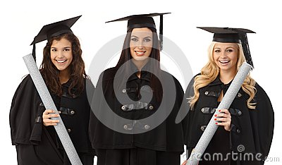Portrait of three female graduates smiling happy