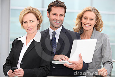 Portrait of three business people outdoors