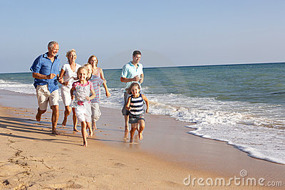 Portrait Of Three Generation Family On Beach