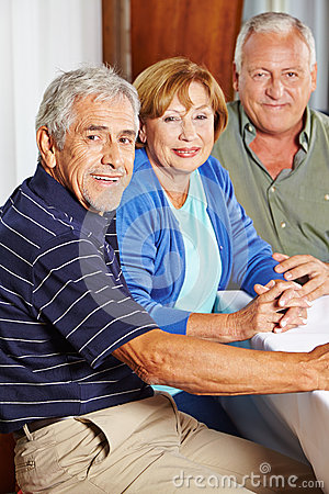 Portrait of three happy seniors