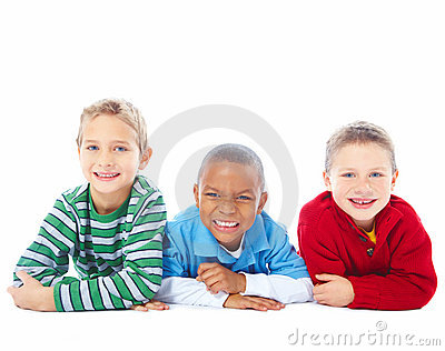 Portrait of three young boys over white background