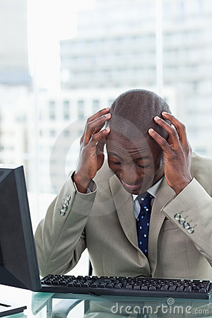 Portrait of a tired office worker using a computer