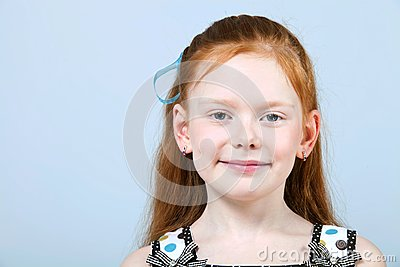 Portrait of trendy red-haired girl