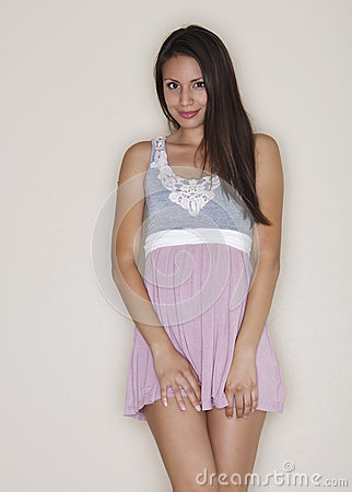 Portrait of trendy young woman in fun dress