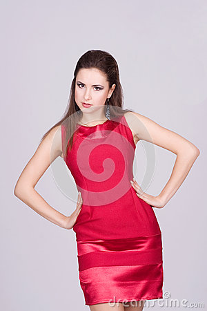 Portrait of trendy young woman in red dress