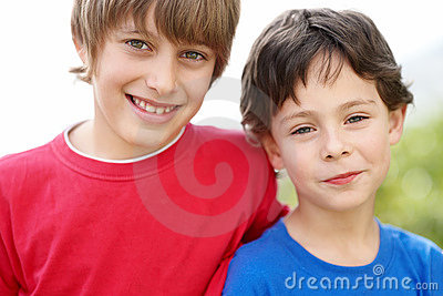 Portrait of two brothers looking happy