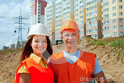 Portrait of two builders